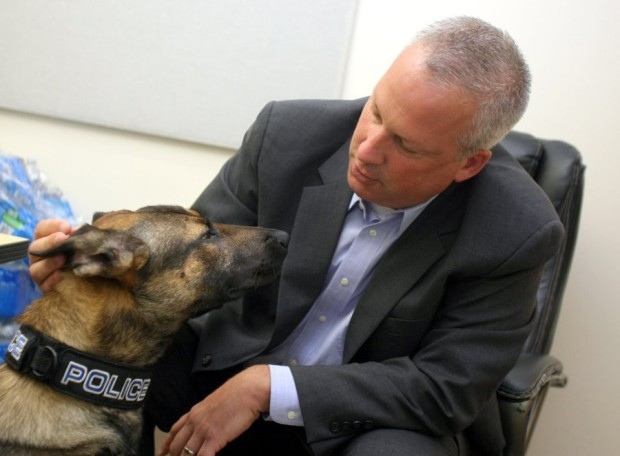 Poulsbo Police Chief Al Townsend with the department's new drug dog Monday. The city has not settled on a name for the dog. (Larry Steagall / Kitsap Sun)